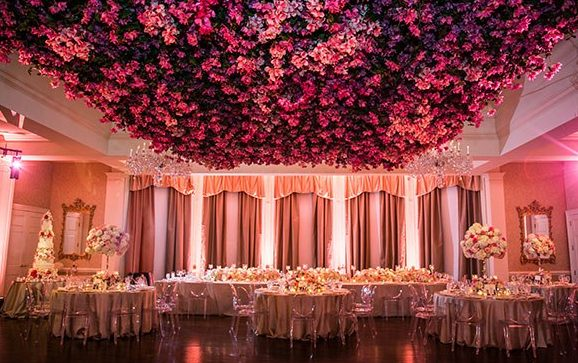 10 wedding trends to behold for 2018 red roses floral ceiling wedding decor junglespirit Gallery