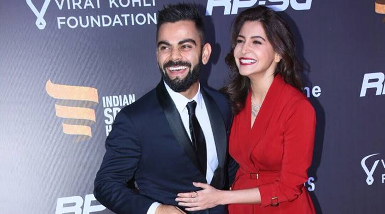 Anushka smiling with Virat Kohli
